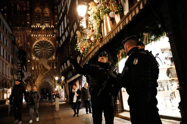 French gendarmes patrol in the streets of the city of Strasbourg, eastern France, following a shooting, Wednesday, Dec. 12, 2018. (AP Photo/Christophe Ena)