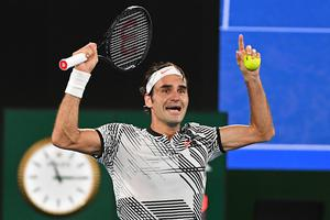 Switzerland's Roger Federer celebrates his victory against Spain's Rafael Nadal during the men's singles final on day 14 of the Australian Open tennis tournament in Melbourne on January 29, 2017. / AFP / WILLIAM WEST