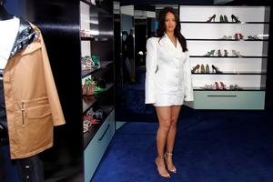 Pop superstar Rihanna poses in a pop-up store to present her first collection with LVMH for the new label, Fenty, which includes ready-to-wear and accessories, such as shoes, sunglasses and jewellery, Paris, France May 22, 2019. Picture taken May 22, 2019.  .  REUTERS/Charles Platiau
