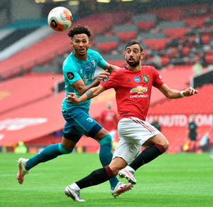 Bournemouth's Lloyd Kelly and Manchester United's Bruno Fernandes battle for the ball. Photo: PA