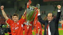 File photo dated 25-05-2005 of Liverpool captain Steven Gerrard (L) and manager Rafael Benitez hold trophy.  Rebecca Naden/PA Wire.