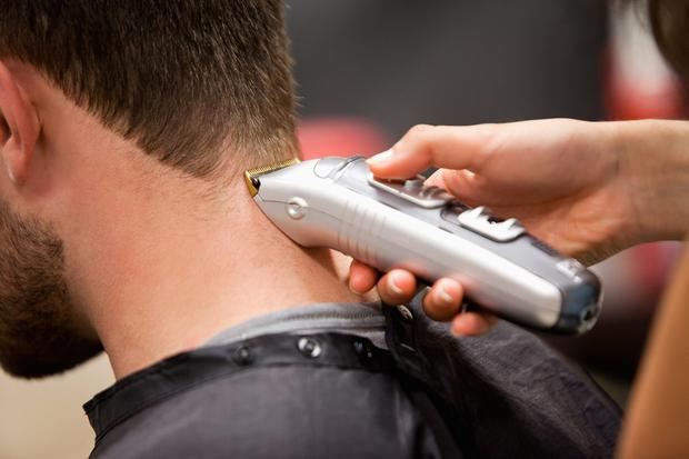 Man having a haircut. Stock picture