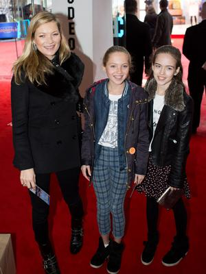 Kate Moss and her daughter Lila Grace (centre) and friend attend the world premiere of Paddington at the Odeon, Leicester Square in central London