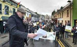 Colm O'Donnell reads aloud a letter to An Taoiseach on behalf of hill sheep farmers who staged a protest outside Enda Kenny's constituency office in Castlebar, Co Mayo. Photo: Michael McLaughlin