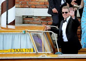 U.S. actor Matt Damon waves as he boards a taxi boat transporting guests to the venue of a gala dinner ahead of the official wedding ceremony of U.S. actor George Clooney  Bianchi (ITALY - Tags: ENTERTAINMENT)