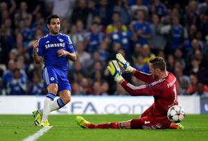 Cesc Fabregas scores the opening goal for Chelsea past Schalke goalkeeper Ralf Faehrmann during the Champions League game at Stamford Bridge. Photo: Mike Hewitt/Getty Images