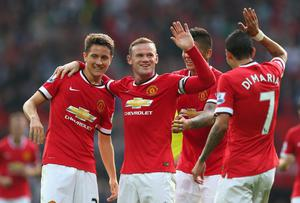 Wayne Rooney celebrates with team-mates Ander Herrera, Marcos Rojo and Angel Di Maria after scoring Manchester United's third goal. Photo by Alex Livesey/Getty Images