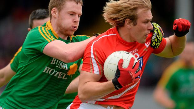 Louth's Conor Grimes in action against Niall Woods of Letrim