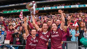 Galway players, from left, Aoife Donoghue, Niamh Hannify and Catriona Cormican celebrate with the O'Duffy Cup and their supporters after their victory over Cork in the All-Ireland Senior Camogie Championship final at Croke Park in Dublin. Photo: Ben McShane/Sportsfile