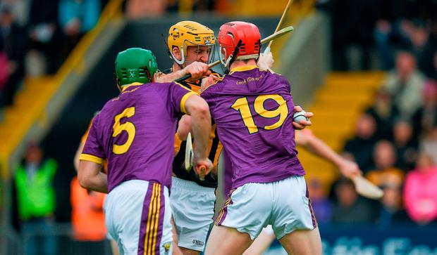 Eoin Murphy of Kilkenny is tackled by Willie Devereux, 19, and Shaun Murphy of Wexford in the move that led to a penelty for Kilkenny in the first minute during the Leinster GAA Hurling Senior Championship Semi-Final match between Wexford and Kilkenny at Wexford Park in Wexford. Photo by Ray McManus/Sportsfile