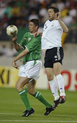 Niall Quinn of Ireland and Thomas Linke of Germany battle for the ball in the Group E match during the World Cupat the Ibaraki-Prefectural Kashima Soccer Stadium. (Photo by Laurence Griffiths/Getty Images)