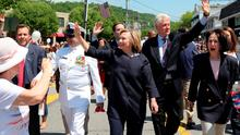 Democratic Presidential candidate Hillary Rodham Clinton and her husband, former President Bill Clinton, march in a Memorial Day Parade in their hometown of Chappaqua, New York, where almost a thousand onlookers crowded the parade route. Photo: The Journal News via AP