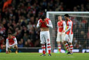 Arsenal's Santi Cazorla stands dejected after their home defeat to Manchester United