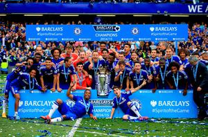 File photo dated 24-05-2015 of Chelsea players celebrate with the trophy after the Barclays Premier League match at Stamford Bridge, London