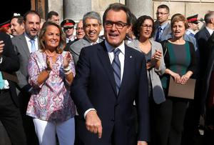 Catalonia's President Artur Mas gestures to pro-independence supporters upon leaving the Palau de la Generalitat after signing a decree calling for an independence referendum, in Barcelona. Mas signed the decree on Saturday calling an independence referendum on Nov. 9, putting him on a collision course with the central government which says such a vote is illegal. Photo credit: REUTERS/Gustau Nacarino
