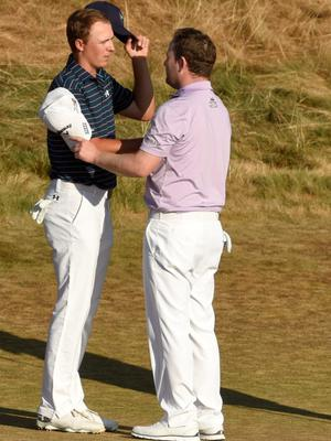 Jun 21, 2015; University Place, WA, USA; Jordan Spieth (left) and Branden Grace shake hands after completing the final round of the 2015 U.S. Open golf tournament at Chambers Bay. Mandatory Credit: John David Mercer-USA TODAY Sports
