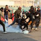 Riot police fire tear gas to disperse anti-government protesters. AP Photo/Hadi Mizban