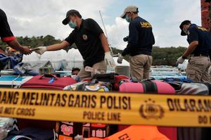 A police forensic team examines a ferry boat which was carrying tourists from the island of Bali to Lombok following an explosion on board, at Padangbai port, Bali, Indonesia September 15, 2016 in this photo taken by Antara Foto