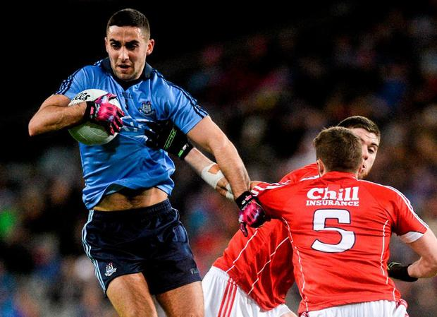 James McCarthy of Dublin charges past Cork's Tomás Clancy and Luke Connolly in the league game last month. Photo: Piaras Ó Mídheach / Sportsfile