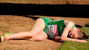 An exhausted Ciara Mageean at the finishing line after the women's senior race. Photo: Eóin Noonan/Sportsfile