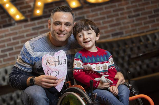 HEART-STEALER: Adam King, with his dad David, was a big hit on The Late Late Toy Show. Photo: Fergal Phillips