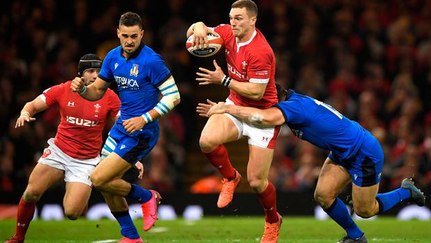 Italy's Luca Morisi tackles Wales' George North. Photo: Getty Images