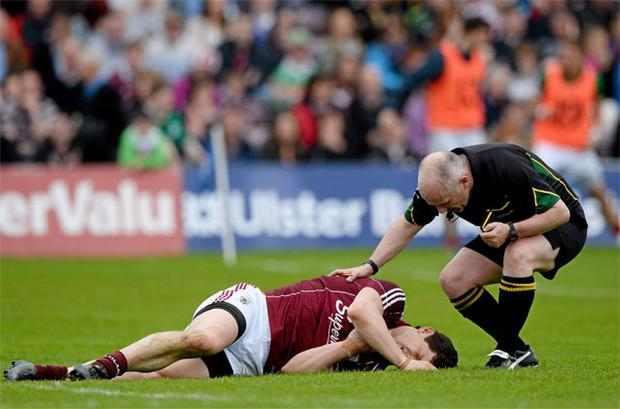 Galway's Michael Meehan holds his shoulder after colliding with Mayo goalkeeper David Clarke, before being forced off