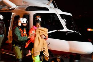 One of the three children that were rescued from the avalanche-hit Rigopiano Hotel is transported to a hospital in Pescara, Friday, Jan. 20, 2017.  (Claudio Lattanzio/ANSA via AP)