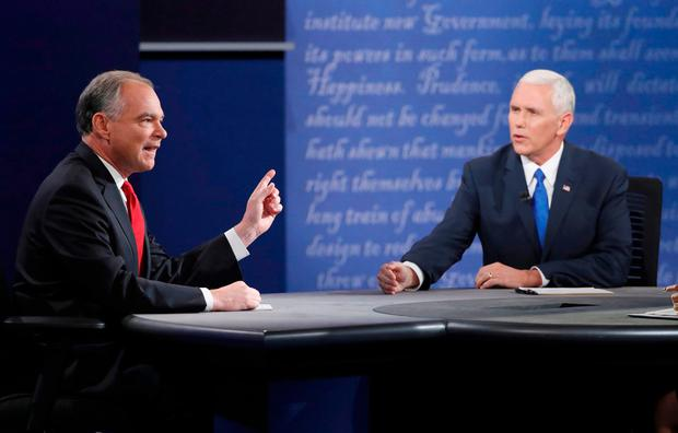 Democratic vice presidential nominee Senator Tim Kaine and Republican vice presidential nominee Governor Mike Pence (R) during their vice presidential debate at Longwood University in Farmville, Virginia. Photo: Reuters
