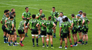 Coach Jason Holland talks to his players during a Hurricanes Super Rugby training session at Rugby League Park, Wellington, New Zealand last week. Photo : Hagen Hopkins/Getty Images