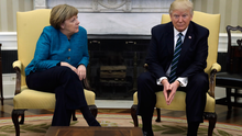 President Donald Trump meets with German Chancellor Angela Merkel in the Oval Office of the White House Photo: AP Photo/Evan Vucci