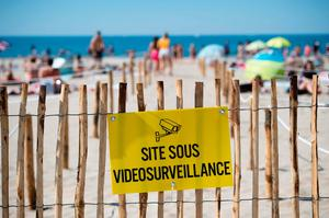 'Couchant or Sunset beach' in roped off distancing zones marked out by the municipality along the beach in La Grande Motte, southern France.(Photo by CLEMENT MAHOUDEAU / AFP) (Photo by CLEMENT MAHOUDEAU/AFP via Getty Images)