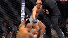 September 2014; Conor McGregor, centre, in action against Dustin Poirier