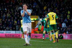 Manchester City's Jesus Navas reacts after missing a scoring opportunity against Norwich City