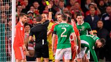Gareth Bale is shown a yellow card by referee Nicola Rizzoli for a late tackle on John O'Shea. Photo: Brendan Moran/Sportsfile