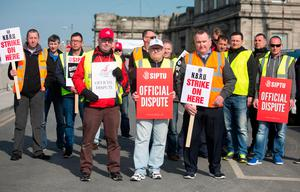 Eamon McGann from Bluebell, Adam Ferguson from Cabra and Gerard Hudson from Inchicore with striking colleagues at the Broadstone Depot. Photo: Gareth Chaney