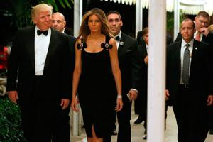 U.S. President-elect Donald Trump and his wife Melania Trump arrive for a New Year's Eve celebration with members and guests at the Mar-a-lago Club in Palm Beach, Florida