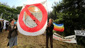 Standing up to power: Anti-Trump protesters Jackie Askew from Ennistymon and Sadbh Burke from Doolin at Shannon airport. Picture: Gerry Mooney