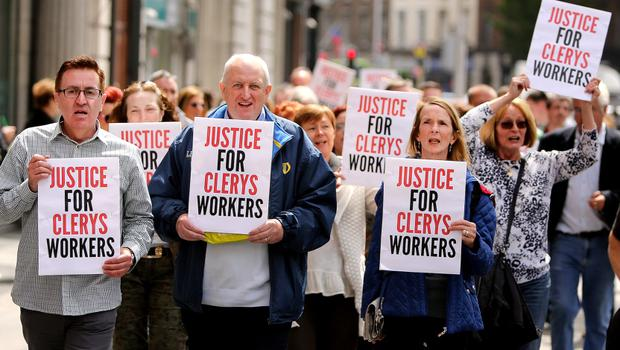 Former Clerys employees march to protest outside the iconic store on Dublins O'Connell street.  Picture;  GERRY MOONEY.  13/6/15