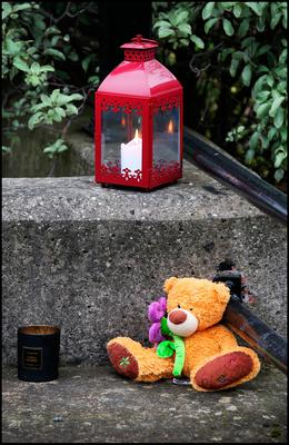 A cuddly teddy bear and candles left at the Riverside apartment at Poddle Park in Kimmage where the young child was stabbed to death. Pic Steve Humphreys