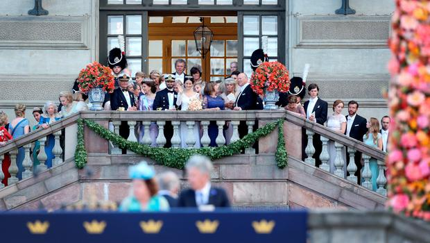 STOCKHOLM, SWEDEN - JUNE 13:  (L-R) King Carl XVI Gustaf of Sweden, his wife Queen Silvia of Sweden, Prince Carl Philip of Sweden and Princess Sofia of Sweden, and her parents Marie Hellqvist and Erik Hellqvist stand in the middle on the stairs greeting the crowds in front of The Royal Palace on June 13, 2015 in Stockholm, Sweden.  (Photo by Ragnar Singsaas/Getty Images)
