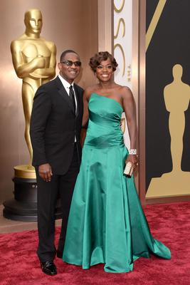 Actors Julius Tennon (L) and Viola Davis attend the Oscars held at Hollywood & Highland Center on March 2, 2014 in Hollywood, California.  (Photo by Jason Merritt/Getty Images)