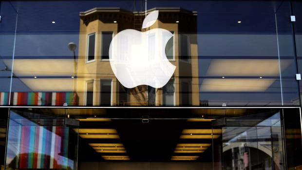 The Apple logo is pictured on the front of a retail store in the Marina neighborhood in San Francisco, California. REUTERS/Robert Galbraith