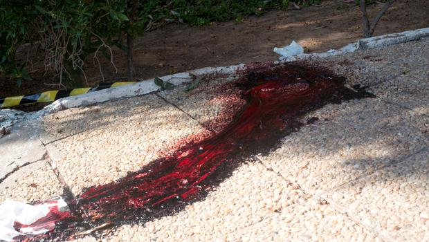 A pool of blood is seen on the ground near the area where a terrorist attack took place in the coastal town of Sousse, Tunisia, Friday June 26, 2015. A young man unfurled an umbrella and pulled out a Kalashnikov, opening fire on European sunbathers in an attack that killed at least 28 people at a Tunisian beach resort  one of three deadly attacks from Europe to the Middle East on Friday that followed a call to violence by Islamic State extremists. (AP Photo/Leila Khemissi)