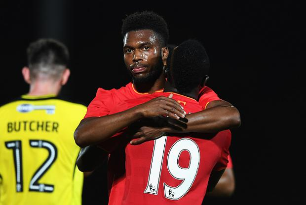 BURTON UPON TRENT, ENGLAND - AUGUST 23: Daniel Sturridge of Liverpool celebrates scoring his team's fifth goal with Sadio Mane during the EFL Cup second round match between Burton Albion and Liverpool at Pirelli Stadium on August 23, 2016 in Burton upon Trent, England. (Photo by Gareth Copley/Getty Images)