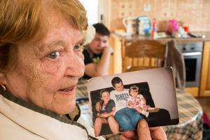 Elizabeth Connors (73) holds a picture of her son Paddy Connors with his daughters Chantelle and Ann. Photo: Mark Condren