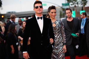 Recording artist Robin Thicke (L) and actress Paula Patton attend the 56th GRAMMY Awards at Staples Center on January 26, 2014 in Los Angeles, California.  (Photo by Christopher Polk/Getty Images for NARAS)