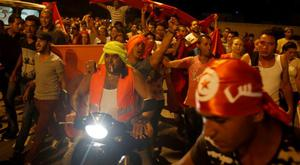People shout slogans during a protest against terrorism in Sousse, Tunisia, Saturday, June 27, 2015. Tunisia's postcard destination for tourists is reeling from the terror that blighted another day of play at the Mediterranean seaside resort of Sousse. A man armed with a Kalashnikov and grenades gunned down tourists on a private beach Friday, and then moved methodically through the grounds of a luxury hotel  to the swimming pool, reception area and offices. (AP Photo/Darko Vojinovic)