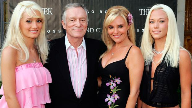 """Playboy's Hugh Hefner poses with Playmates Holly Madison (L), Bridgett Marquardt and Kendra Wilkinson (R) at a special screening of Dennis Hopper's """"The Last Movie"""", newly restored, at the Playboy Mansion on May 31, 2005 in Holmby Hills, California. Photo by Kevin Winter/Getty Images)"""