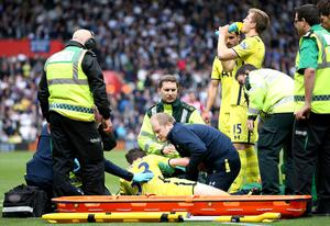 Tottenham's Ben Davies recieves medical attention after sustaining an injury before being substituted